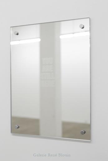 YOU ARE STILL HERE 2013, édition : 13/15, miroir, metal, 38 x 29,2 x 0,5 cm / 14 x 11.5 x 1.27 pouces, Vue de l'exposition : Mona Hatoum SALLES 1 ET 2 27 septembre au 8 novembre 2014, Photo: Guy L'Heureux